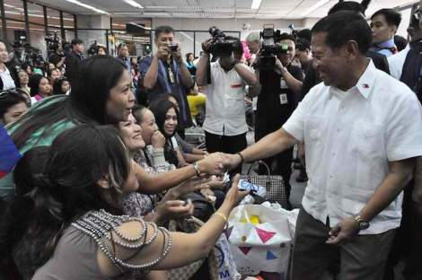Vice President Jejomar Binay greets Filipino repatriates who arrived from Syria on Tuesday, September 11, 2012, at the NAIA terminal 1.
